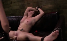 Tied up lesbian gets pussy smashed