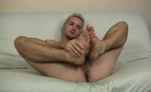 Hot blond dude Jason Lee loves giving his big feet a hot rub