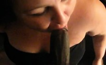 BBW sucks on cum from penis that is black