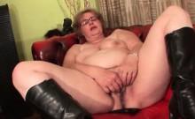 Mature in glasses masturbates on leather sofa