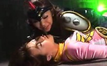 Pretty Oriental girl in a pink outfit is introduced to lesb