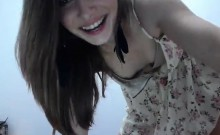 Alluring brunette teen in a sexy dress sensually flashes he