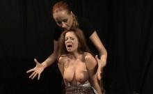 Busty ginger punished in bondage action