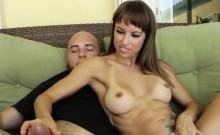 Busty Milf Wanking Off Cock With Both Hands