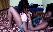 Amateur African lesbos love playing with strapon
