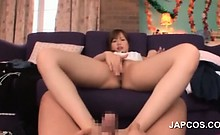 Excited teen Japanese rubbing her pussy while giving footjob