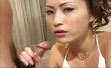 Japanese goddess in white on her knees sucking dick