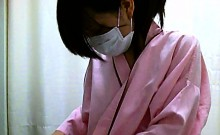 Spy cam catches a couple of Japanese cuties trying on cloth