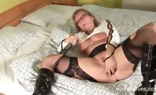 Mature hottie in stockings masturbating pussy with vibrator