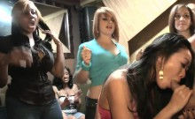 Excited stripper is getting his knob sucked by several babes
