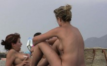 Having fun posing on public nudist beach