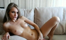 hot blonde with oiled big tits plays on sofa